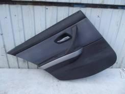 Обшивка двери BMW 320D, левая задняя