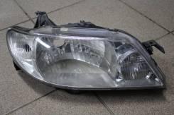 Фара Mazda Familia 2000-2003 г. (13-64) Права сторона . оригинал бу.