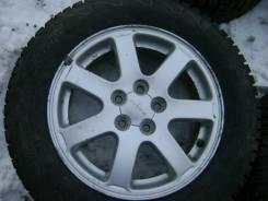 Диски от Subaru impreza, с резиной Cordiant Snow Cross 195/65/R15.