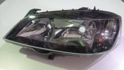 Фара передняя левая Opel Astra G затемненная