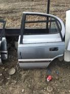 Дверь левая задняя Toyota Corolla