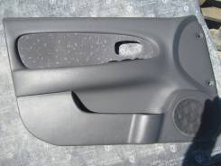 Обшивка двери передней левой Kia Spectra