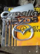 Эмблема Mazda Capella 97-2002 гг