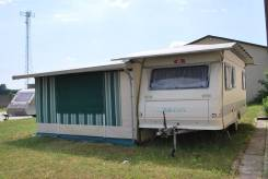 Adria Unica. Дом на колесах c большой каркасной алюминиевой палаткой