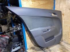 Обшивка задней левой двери Opel Astra H 79081