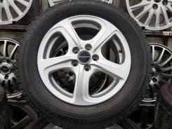 "Bridgestone Blizzak Revo 01 195/65R15. 6.0x15"" 5x100.00 ET45 ЦО 73,1мм."