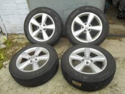 Продаю комплект оригинальных летних колес Nissan на 17(5*114.3) 215/60