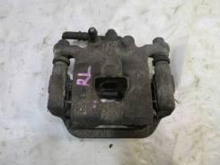 Суппорт тормозной задний левый Nissan Serena 44011-CY000
