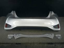 Бампер задний Toyota Vitz (52159-52870/B0) NHP130