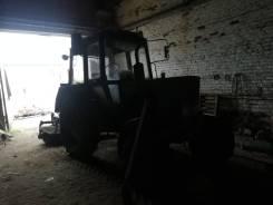 МТЗ 82. Трактор с передним снежным отвалом и щеткой