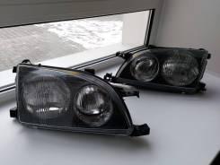 Фара Toyota Avensis / Caldina 97-00 черная