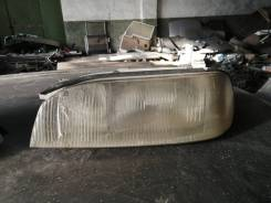 Фара левая Toyota Camry sv30 4sfe