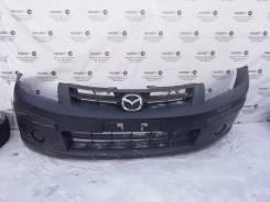 Передний бампер Mazda Familia