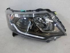 Правая фара Honda STEP WGN 33100-TAA-911. Внутренняя часть дымчатая.