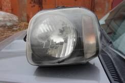 Фара левая на Suzuki Jimny jb23