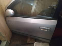 Дверь Nissan Tino