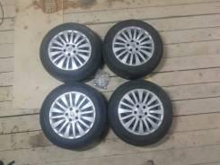 Продаю комплект колес 5/100 с резиной и фирменными колпаками.
