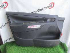 Обшивка двери пер. лев. Peugeot 207