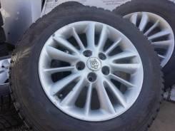 Оригинальные литые диски Toyota на шинах Dunlop 215/60R16
