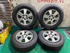 Оригинальные диски Subaru на жирном Yokohama Geolandar 205/70R15