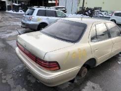 Стекло заднее Toyota Camry