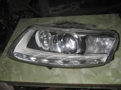 Фара левая Audi A6 (C6F4)