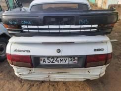 Передний бампер Тойота Камри sv30