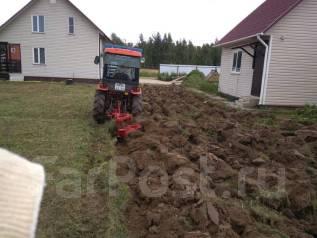 Вспашка земельного участка трактором