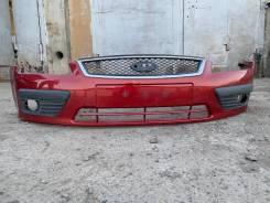 Передний оригинальный дорестайлинговый бампер на Форд Фокус 2
