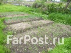 Продается отдельный участок 15 соток на Сахпоселке в Уссурийске. 1 559кв.м., собственность, электричество, вода. Фото участка