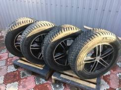 Комплект шипованных колёс на красивом черном литье.
