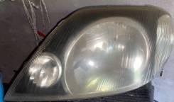 Фара левая (темная) Toyota Corolla Fielder NZE [811501E480]