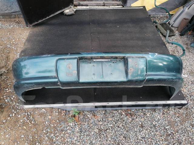 Бампер Toyota Cavalier, задний TJG00