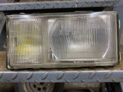 Фара Nissan Caravan E24, левая